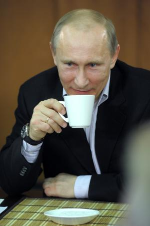 In this photo taken on Saturday, Feb. 4, 2012, Russian Prime Minister Vladimir Putin drinks tea as he speaks to amateur hockey players during a visit in the Perm region in the Ural Mountains, about 1500 kilometers (950 miles) east of Moscow, Russia. (AP Photo/RIA-Novosti, Alexei Nikolsky, Government Press Service)