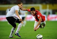 Austria's Zlatko Junuzovic (R) fights for the ball with Germany's Benedikt Hoewedes during their 2014 World Cup qualification football match at the Ernst Happel Stadium, in Vienna. Germany won 2-1