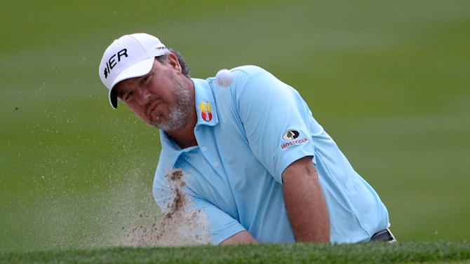Boo Weekley hits out of a bunker onto the 15th green during the final round of the Arnold Palmer Invitational golf tournament in Orlando, Fla., Sunday  March 24, 2013.(AP Photo/Phelan M. Ebenhack)
