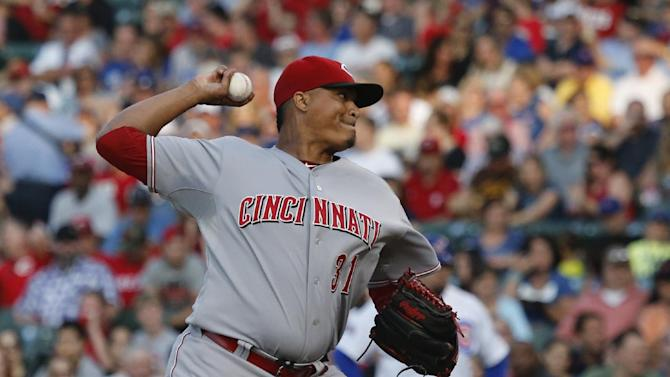 Reds score 5 in ninth, beat Cubs 6-1