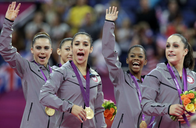 U.S. gymnasts, left to right, McKayla Maroney, Kyla Ross, Alexandra Raisman, Gabrielle Douglas and Jordyn Wieber celebrate during the medal ceremony of the Artistic Gymnastics women&#39;s team final at the 2012 Summer Olympics, Tuesday, July 31, 2012, in London. U.S. won the gold. (AP Photo/Julie Jacobson)