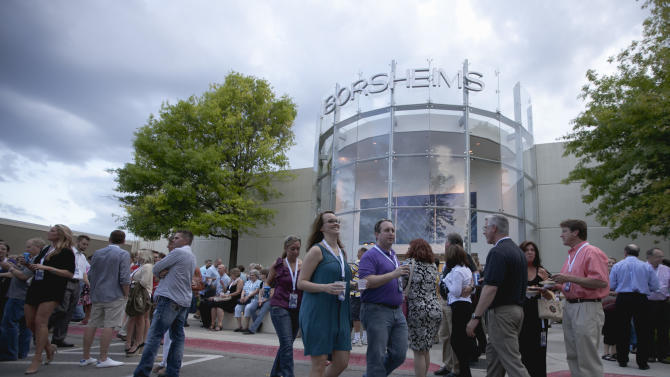 Shareholders join a cocktail party outside the Berkshire-owned Borsheims jewelry store in Omaha, Neb., Friday, May 4, 2012. Berkshire Hathaway is expected to have 30,000 shareholders come to Omaha for it's annual shareholders meeting this weekend. (AP Photo/Nati Harnik)