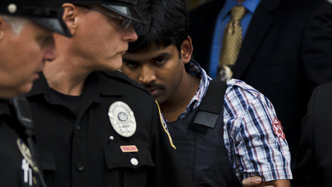 Raghunandan Yandamuri is escorted from a Montgomery County district court after an arraignment Friday, Oct. 26, 2012, in Bridgeport, Pa.  Investigators said Yandamuri killed 10-month-old Saanvi Venna and her grandmother Satyavathi Venna in a botched ransom kidnapping. He is being held without bail on murder, kidnapping and other charges. (AP Photo/Matt Rourke)