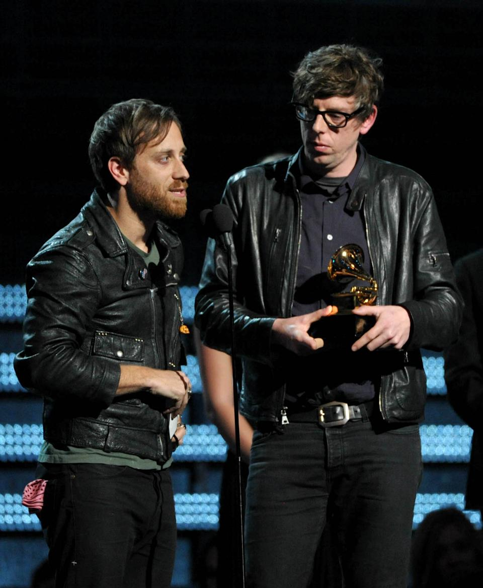 "Musicians Dan Auerbach, left, and Patrick Carney of the Black Keys accept the award for best rock performance for ""Lonely Boy"" at the 55th annual Grammy Awards on Sunday, Feb. 10, 2013, in Los Angeles. (Photo by John Shearer/Invision/AP)"