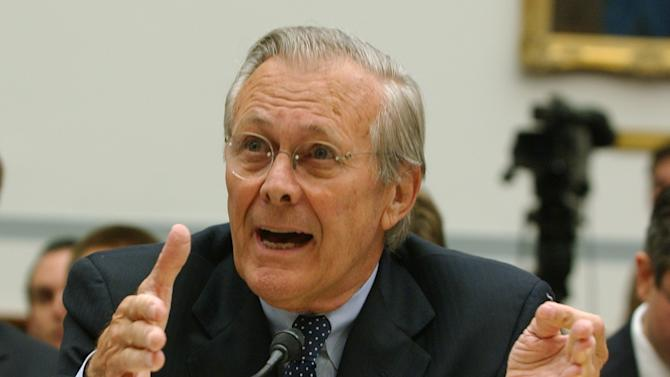 FILE - In this Aug. 1, 2007, file photo, former Defense Secretary Donald Rumsfeld testifies on Capitol Hill in Washington. A federal judge says Rusmfeld can be sued personally for damages by a former U.S. military contractor who says he was tortured during nine months in prison in Iraq. (AP Photo/Dennis Cook, File)