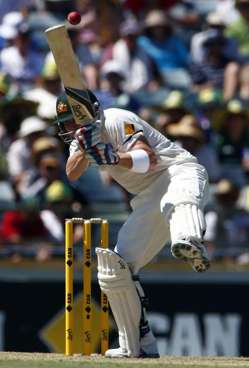 Australia's Haddin avoids a bouncer bowled by England's Broad during the first day of the third Ashes cricket test at the WACA ground in Perth