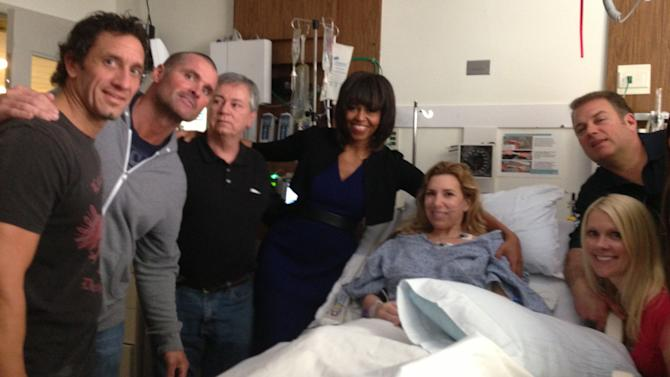 This April 18, 2013 photo provided by Alfred Colonese shows from left Alfred Colonese, Mick Henn, Dale Abbott, first lady Michelle Obama, Heather Abbott, Jason Geremia, and Michelle Dalrymple at Brigham and Women's Hospital in Boston. Heather Abbott was scrambling to get off the sidewalk when the force of the second blast blew her through the restaurant doorway. The day of the bombings, Abbott and a half-dozen friends took in the traditional Patriots' Day Red Sox game at Fenway Park. They left the match early and headed to Forum, where former New England Patriots were gathered to raise money for offensive guard Joe Andruzzi's cancer foundation, and where another friend was tending bar.  (AP Photo/Courtesy of Alfred Colonese)
