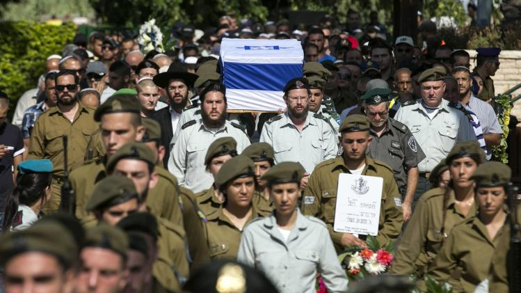 Relatives and friends attend the funeral of Israeli soldier Adi Briga who was killed on Monday by a Palestinian mortar strike from the Gaza Strip in Ashkelon