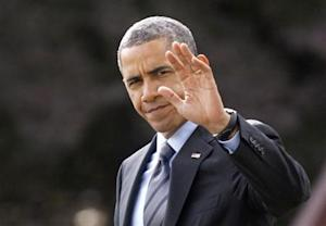 Obama waves on the South Lawn of White House in Washington
