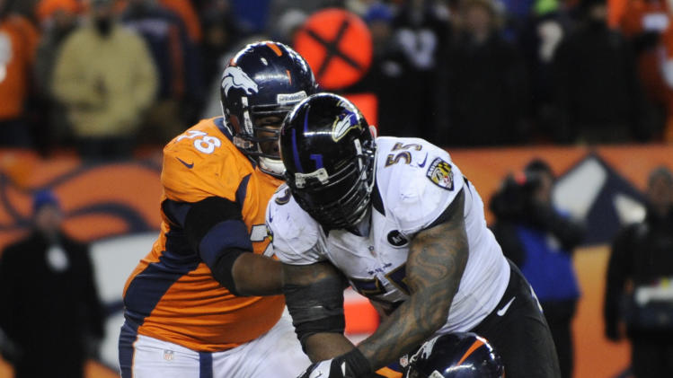 Denver Broncos quarterback Peyton Manning (18) is sacked by Baltimore Ravens outside linebacker Terrell Suggs (55) as Denver Broncos tackle Ryan Clady blocks in the fourth quarter of an AFC divisional playoff NFL football game, Saturday, Jan. 12, 2013, in Denver. (AP Photo/Jack Dempsey)