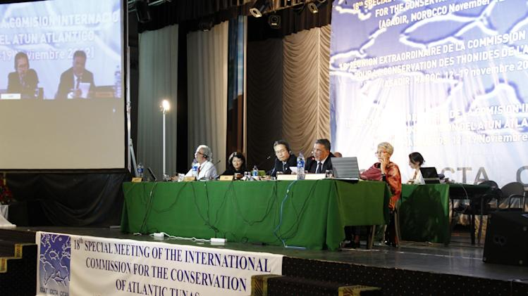 Chairmen for the International Commission for the Conservation of Atlantic Tuna address delegates at the closing of the conference in Agadir, Morocco, on Monday, Nov. 19, 2012. Member nations of the fisheries group agreed to maintain strict quotas to stop overfishing of severely depleted bluefin tuna stocks. (AP Photo/Paul Schemm)
