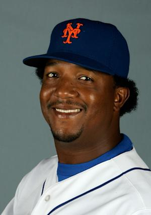 "FILE - This is a 2008 file photo of Pedro Martinez of the New York Mets baseball team. Martinez the three-time Cy Young Award winner has a book deal with Houghton Mifflin Harcourt. The publisher announced Wednesday Oct. 2, 2013 that ""Pedro"" will be published next year and will be co-written by the Boston Herald's Michael Silverman. (AP Photo/Nati Harnik, File)"