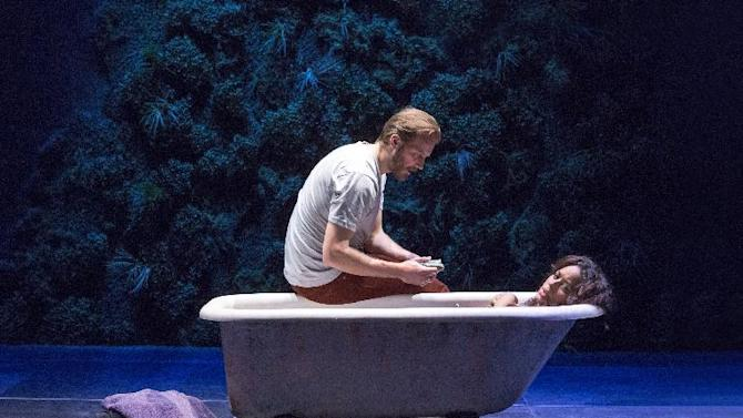 """This theater image released by The Hartman Groups shows Bill Heck, left, and Liza Colon-Zayas during a performance of """"Water By The Spoonful,"""" a play by Quiara Alegria Hudes. (AP Photo/The Hartman Group, Richard Termine)"""