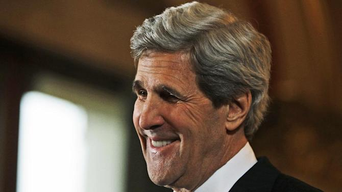 US Secretary of State John Kerry reacts after listening a reporter's question during a joint news conference with Britain's Foreign Secretary William Hague, not seen, following their meeting in central London, Monday, Feb. 25, 2013. This is the first overseas trip for the US Secretary of State in his new role. (AP Photo/Lefteris Pitarakis, pool)
