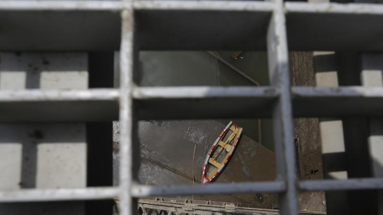An empty boat is seen in a dry chamber of the Miraflores locks during its periodical maintenance at the Panama Canal in Panama City