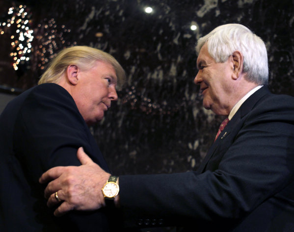 Republican presidential candidate, former House Speaker Newt Gingrich and Donald Trump shake hands after they met and spoke to the media in New York, Monday, Dec. 5, 2011. (AP Photo/Seth Wenig)