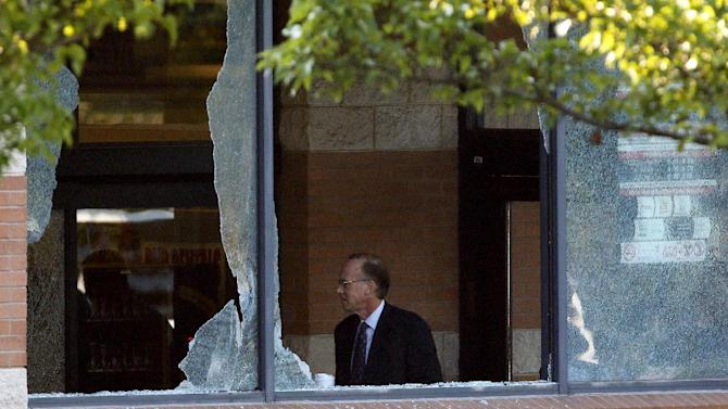 Middlesex County prosecutor Bruce Kaplan inspects the scene of a shooting at a Pathmark grocery store in Old Bridge, N.J., Friday, Aug. 31, 2012. An employee of the supermarket opened fire at the closed store early Friday as a dozen or more colleagues worked inside, killing two of them and himself, Kaplan said. (AP Photo/Julio Cortez)