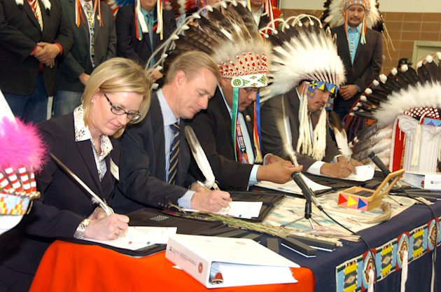 <p>               Representatives of Cloud Peak Energy and Montana's Crow Tribe sign an agreement Thursday Jan. 24, 2013, that gives the mining company leasing options on 1.4 billion tons of coal beneath the Crow Indian Reservation, in Billings, Mont. Pictured from left are Cloud Peak legal counsel Amy Stefonick, company chief executive Colin Marshall, Crow Tribal Chairman Darrin Old Coyote and Tribal Executive Secretary Alvin Not Afraid. The deal would expand mining on the reservation with the coal likely to be exported overseas. (AP Photo/Matthew Brown)