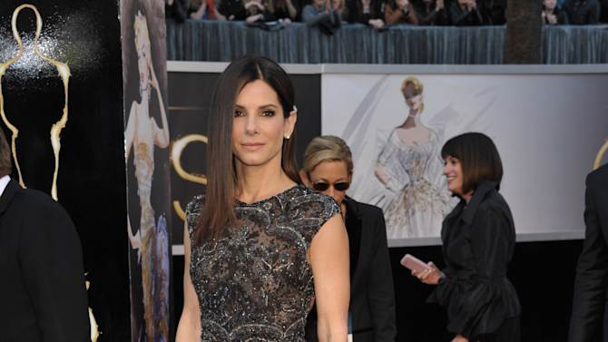 Actress Sandra Bullock arrives at the Oscars at the Dolby Theatre on Sunday Feb. 24, 2013, in Los Angeles. (Photo by John Shearer/Invision/AP)