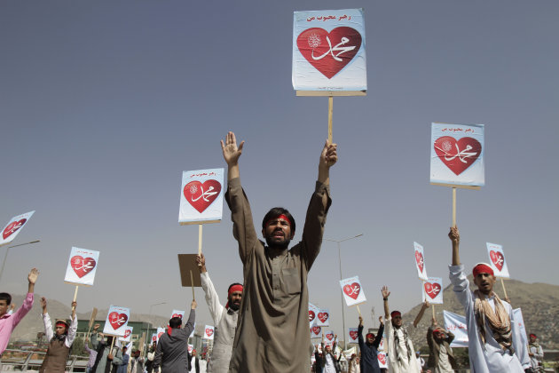 "Afghans hold placards reading: ""Our leader Mohammed"" during a protest against an anti-Islam film in Kabul, Afghanistan, Thursday, Sept. 20, 2012. (AP Photo/Ahmad Jamshid)"