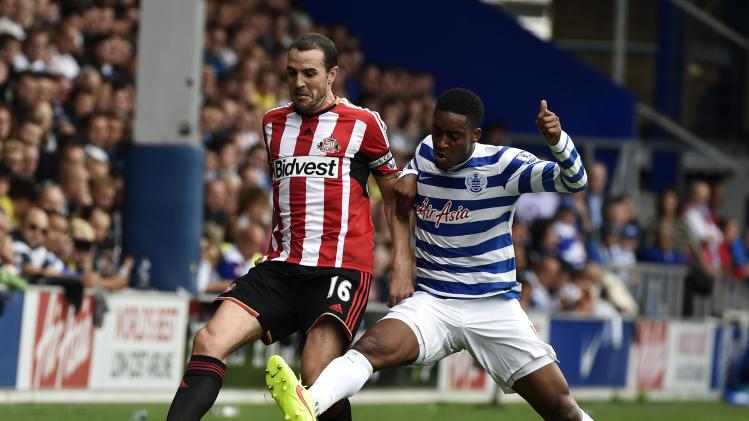 Sunderland's O'Shea challenges Queens Park Rangers' Fer during their English Premier League soccer match at Loftus Road in London