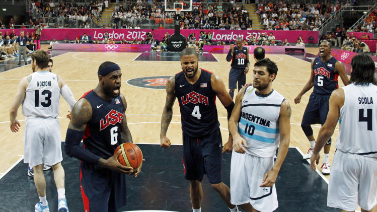 Lebron James, left, of the U.S. and teammate Tyson Chandler, center, yell as Argentina's Carlos Delfino, right, was called for a foul during their men's preliminary round basketball match at the 2012 Summer Olympics on Monday, Aug. 6, 2012, in London. (AP Photo/Mike Segar, Pool)