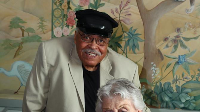 "Actors James Earl Jones, left, and Angela Lansbury pose for photos after discussing their rolls in the play ""Driving Miss Daisy"" in Sydney, Australia, Monday, Jan. 7, 2013. Jones and Lansbury, in Australia to star in a touring production of Alfred Uhry's Pulitzer-Prize winning play ""Driving Miss Daisy,"" credit the thrill of performing with their seemingly endless supply of energy, which has propelled them throughout their decades-long careers. (AP Photo/Rick Rycroft)"