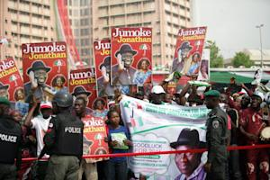 Supporters of the Nigerian president gather during …
