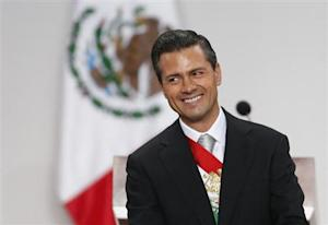 Mexico's President Pena Nieto smiles after his annual state of the union address in Mexico City