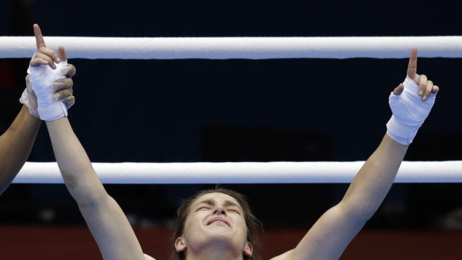 Ireland's Katie Taylor, celebrates winning her fight against Russia's Sofya Ochigava, in a women's lightweight 60-kg gold medal boxing match at the 2012 Summer Olympics, Thursday, Aug. 9, 2012, in London. (AP Photo/Patrick Semansky)