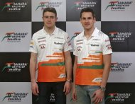 Force India Formula One drivers Adrian Sutil (R) of Germany and Paul di Resta of Britain pose for a picture during a pre-season interview in Mumbai March 8, 2013. A year out of Formula One has increased Sutil's desire to be a world champion and made him mentally stronger, the Force India driver said on Friday. Sutil sealed his Formula One comeback last week with the Silverstone-based team giving the German racer a second chance as team mate to Britain's Paul Di Resta this season. REUTERS/Vivek Prakash (INDIA - Tags: SPORT MOTORSPORT)