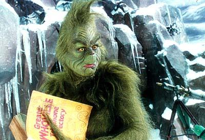 The Grinch ( Jim Carrey ) on Mount Crumpit in Universal's Dr. Seuss' How The Grinch Stole Christmas
