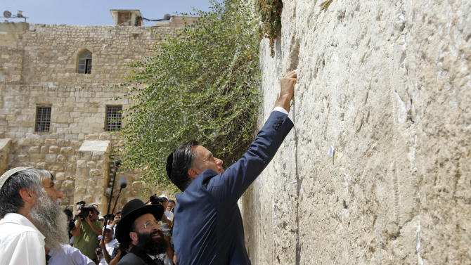 Republican presidential candidate and former Massachusetts Gov. Mitt Romney places a prayer note as he visits the Western Wall in Jerusalem, Sunday, July 29, 2012. (AP Photo/Charles Dharapak)