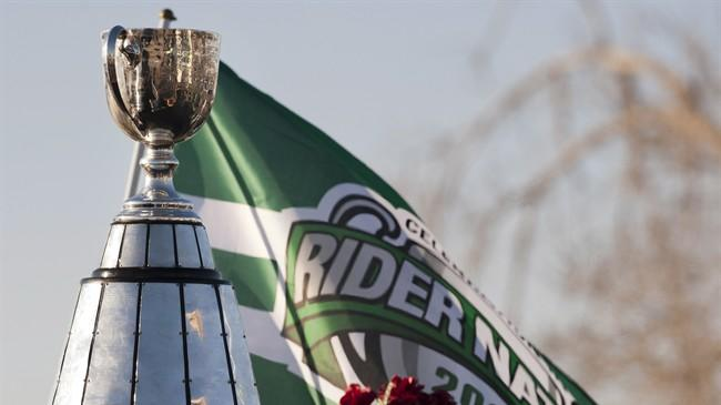 The Grey Cup sits on a float with a Rider nation flag behind it during the Grey Cup parade on Tuesday November 26, 2013 in Regina. The Saskatchewan Roughriders defeated the Hamilton Tiger-Cats 45-23 in the 101st CFL Grey Cup. THE CANADIAN PRESS/Liam Richards