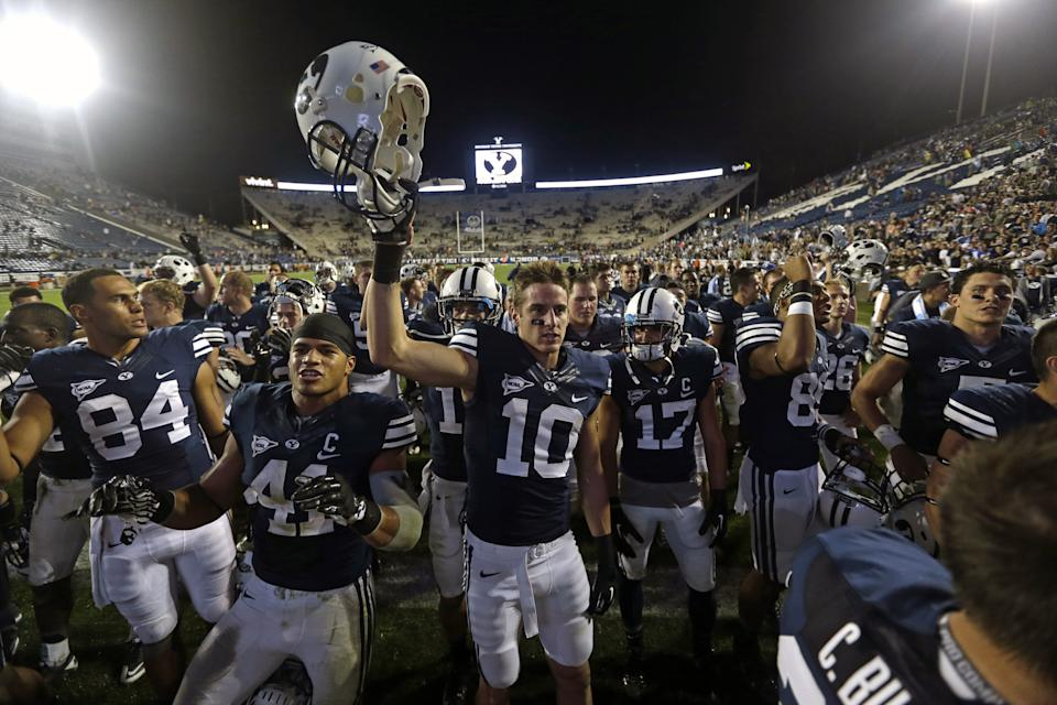 Brigham Young's Devin Mahina (84), Michael Alisa (42) and Mitch Mathews (10) celebrate with other players following their NCAA college football game against Texas Saturday, Sept. 7, 2013, in Provo, Utah. BYU defeated Texas 40-21. (AP Photo/Rick Bowmer)