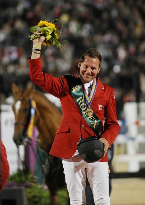 Eric Lamaze from Canada salutes the crow