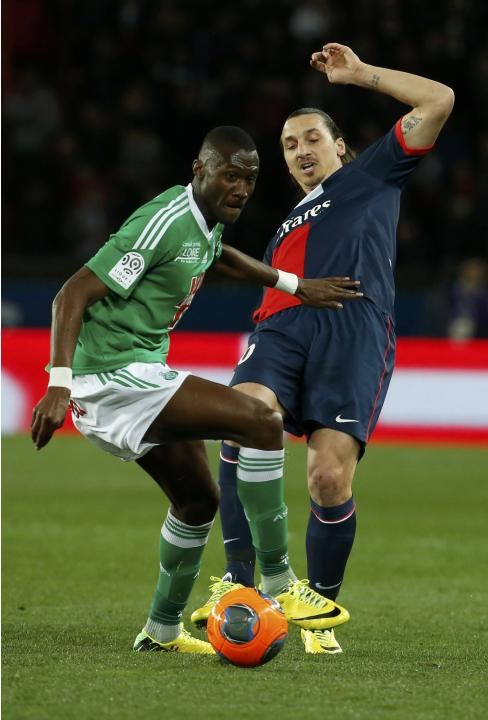 St Etienne's Guilavogui challenges Paris St Germain's Ibrahimovic during their French Ligue 1 soccer match at the Parc des Princes Stadium in Paris