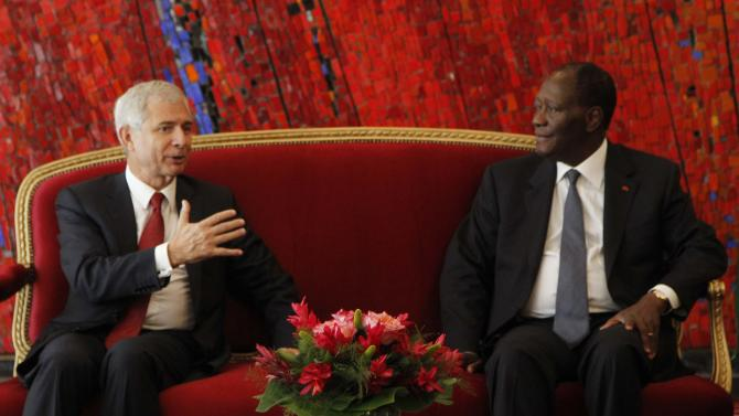 President of the French National Assembly Bartolone talks with Ivory Coast president Ouattara at the presidential palace in Abidjan