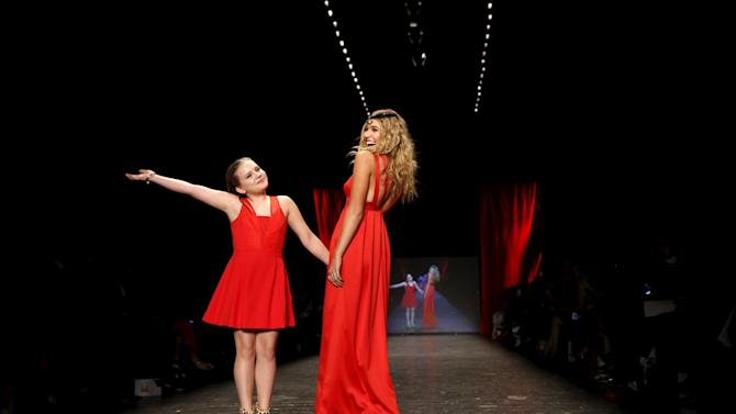 Maisy and Lennon Stella present a creation during the American Heart Association's (AHA) Go Red For Women Red Dress Collection, presented by Macy's at New York Fashion Week.