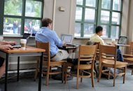 People use their laptop computers in Washington, DC. The Internet is set for a major upgrade in the coming week, but if all goes well, users won&#39;t even know it&#39;s happening