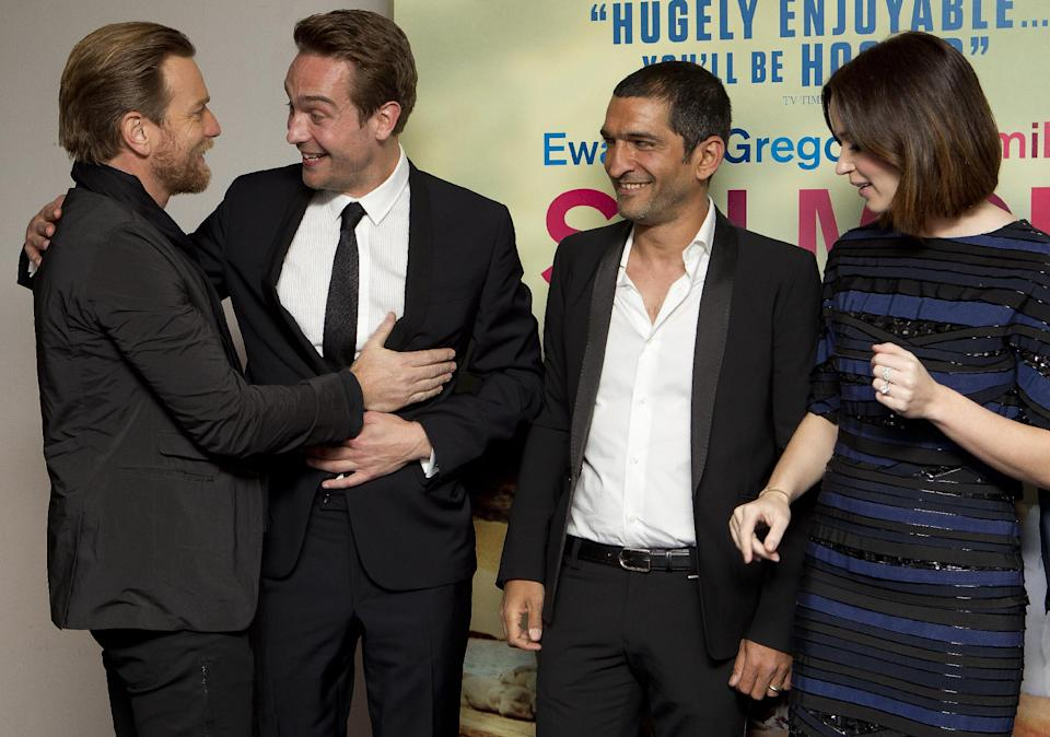 British actors Ewan McGregor greets Tom Mison as Egyptian actor Amr Waked and Emily Blunt look on as they arrive at the 'Salmon Fishing In The Yemen' European premiere at a west London cinema, Tuesday, April 10, 2012. (AP Photo/Joel Ryan)