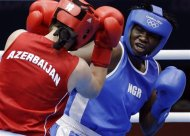 Elena Vystropova of Azerbaijan, left, and Edith Ogoke of Nigeria, fight during the women's 75-kg middleweight boxing competition at the 2012 Summer Olympics, Sunday, Aug. 5, 2012, in London. (AP Photo/Patrick Semansky)