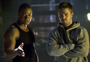 David Ramsey and Stephen Amell | Photo Credits: Jack Rowand/The CW