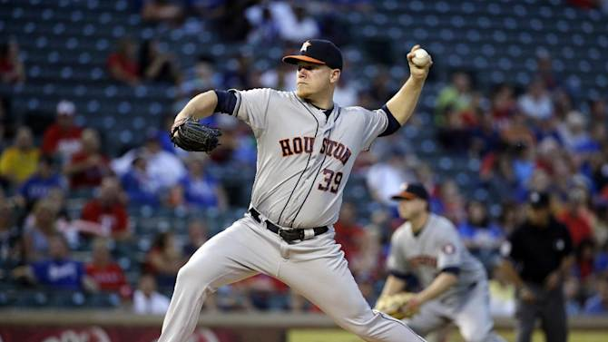 Houston Astros starting pitcher Brett Oberholtzer winds up to deliver to the Texas Rangers in the first inning of a baseball game, Tuesday, Sept. 23, 2014, in Arlington, Texas. (AP Photo/Tony Gutierrez)