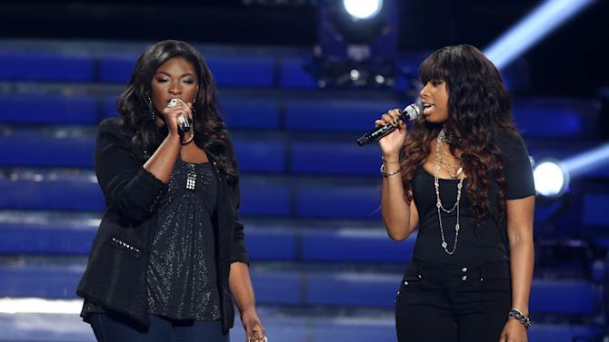 """Finalist Candice Glover, left, and Jennifer Hudson perform at the """"American Idol"""" finale at the Nokia Theatre at L.A. Live on Thursday, May 16, 2013, in Los Angeles. (Photo by Matt Sayles/Invision/AP)"""
