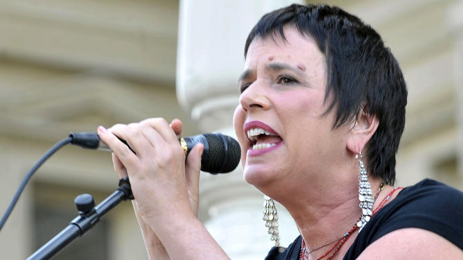 """FILE - This June 18, 2012 file photo shows Eve Ensler, author of """"The Vagina Monologues,"""" speaks during a performance of her play by Democratic state Rep. Lisa Brown, 10 other lawmakers and several actresses on the Michigan Statehouse steps, in Lansing, Mich. Brown, who says she was barred from speaking in the Michigan House because Republicans objected to her saying """"vagina"""" during debate over anti-abortion legislation, performed with help from author Ensler. (AP Photo/Detroit News, Dale G. Young)"""