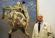 Australian artist Tim Storrier stands beside his painting &#39;The Histrionic Wayfarer (after Bosch)&#39; after winning the 91st Archibald Prize at the Art Gallery of NSW in Sydney, on March 30. The Archibald Prize is one of Australias oldest and most prestigious art prizes