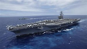 USS Nimitz aircraft carrier sails about 150 miles north of the island of Oahu during the RIMPAC Naval exercises off Hawaii