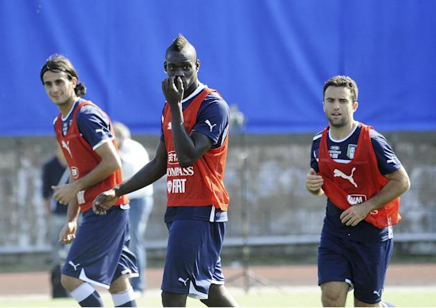 From left, Italy's Alberto Aquilani, Mario Balotelli and Giuseppe Rossi, during a training session with their team at the Giarrusso stadium in the outskirts of Naples, Monday, Oct. 14, 2013, ahead of