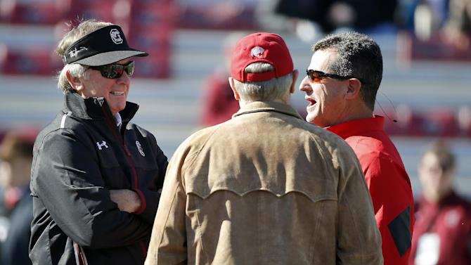 South Carolina head coach Steve Spurrier, left, talks with South Alabama head coach Joey Jones, right, and South Alabama supporter James A. Yance, center, before the start of an NCAA college football game in Columbia, S.C., Saturday, Nov. 22, 2014